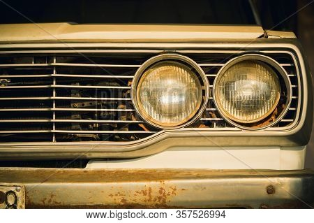 Close Up Headlight Lamp Of Old Classic Car.
