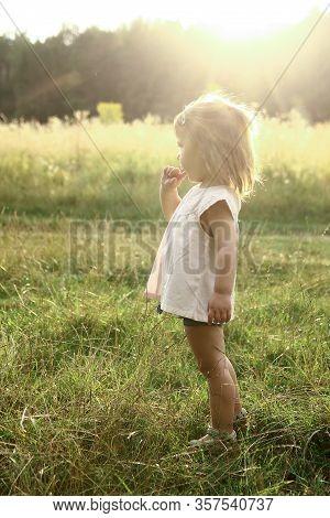 Cute Happy Little Girl Walks In Nature...