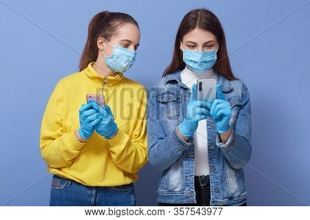 Image Of Nervous Interested Young Females Standing Isolated Over Blue Background, Curious Lady Looki
