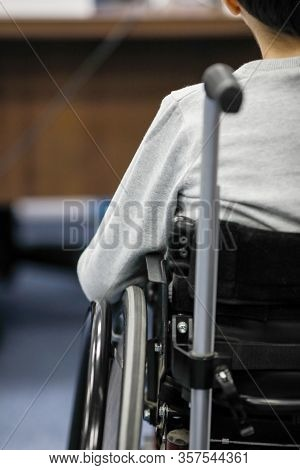 Details Of An Ill Disabled Young Boy In A Wheelchair.