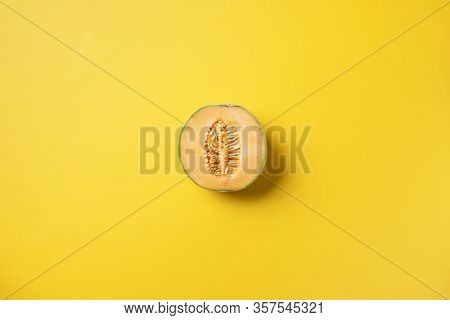 Creative Layout Made Of Melon On Yellow Background. Top View. Copy Space. Flat Lay. Food Concept. Ex