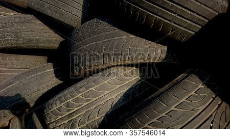 Pile Of Unused Tires In The Junkyard