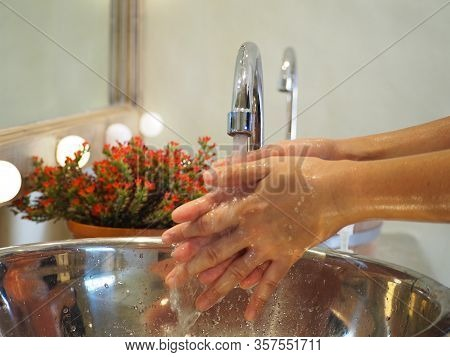 Washing Hands With Water Under The Auto Faucet.hygiene Concept.