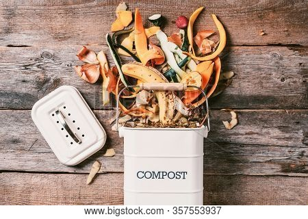 Recycle Kitchen Waste. Sustainable And Zero Waste Living. Vegetable Waste In Recycling Compost Pot.