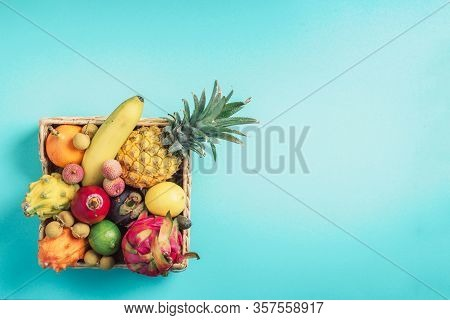 Rattan Box Full Of Exotic Thailand Fruits - Pineapple, Pitahaya, Kiwano, African Horned Melon, Tamar