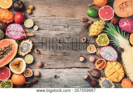Tropical Fruits Concept. Exotic Fruits - Pineapple, Papaya, Mango, Annona, Banana, Pitahaya, Kiwano,