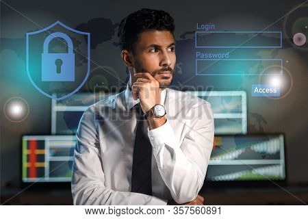 Pensive Bi-racial Trader Looking Away Near Login And Password Letters In Office
