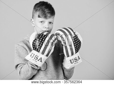 Confident In His Strength. Start Boxing Career. Boy Sportsman Wear Boxing Gloves With Usa Flag. Amer
