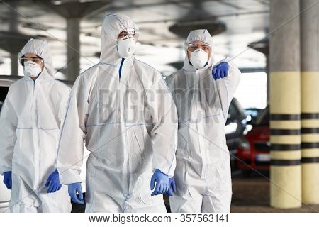 Time To Protect Yourself, Stay At Home. Men In Hazmat Suits Pointing At You, Epidemic, Quarantine, C