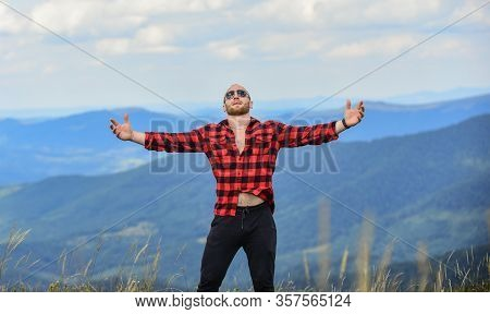 Man Stand On Top Of Mountain. Hug Whole World. Hiking Concept. Active Leisure. Guy Enjoy Freedom. Ma