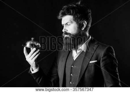 Something Special. Man Well Groomed Bearded Gentleman Formal Suit Hold Little Cloche. Serving And Pr