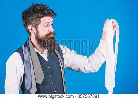 A Wonderful Necktie To A Classic Look. Brutal Caucasian Hipster Holding Necktie. Bearded Man With Ne