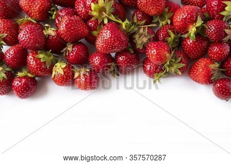 Strawberries On White Background. Ripe Berries Close-up. Strawberries At Border Of Image With Copy S