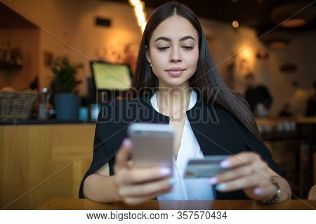 Confident Business Woman Online Payment Via Mobile Phone Using Credit Debit Card While Relaxing In R