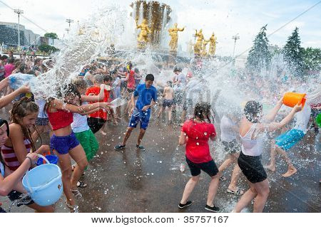 MOSCOW - JULY 14: Young people shooting and throwing water at each other during flash mob