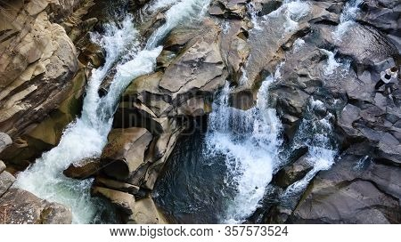 Waterfall Top Down View. Top View Of The Stream, Water Flows Over The Stones. Rocky Mountain Waterfa