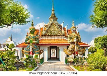 Beautiful Gates Of Ordination Hall With Statues Of Giants, Demon Guardians. Wat Arun Temple, Bangkok