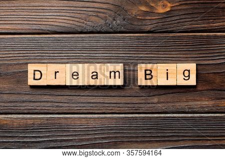 Dream Big Word Written On Wood Block. Dream Big Text On Wooden Table For Your Desing, Top View Conce