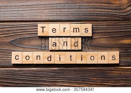 Terms And Conditions Word Written On Wood Block. Terms And Conditions Text On Wooden Table For Your