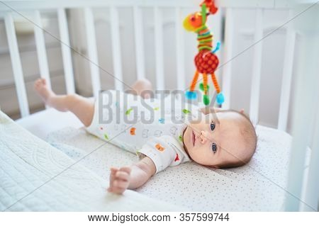Adorable Baby Girl Lying In The Crib. Little Child Having A Day Nap In Cot. Infant Kid Resting And P