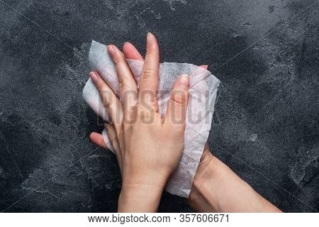 Hands Are Wiped With A Damp Antibacterial Cloth. The Concept Of Hand Cleanliness And The Fight Again