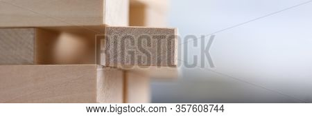 Close-up Wooden Blocks Stacked In Construction. Realization Ideas And Development Abilities. Quality