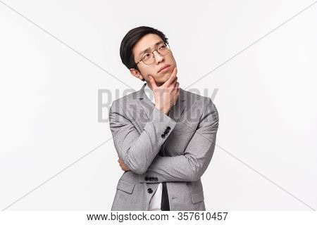Waist-up Portrait Of Thoughtful, Creative And Smart Asian Young Man In Grey Suit, Office Manager, Bu