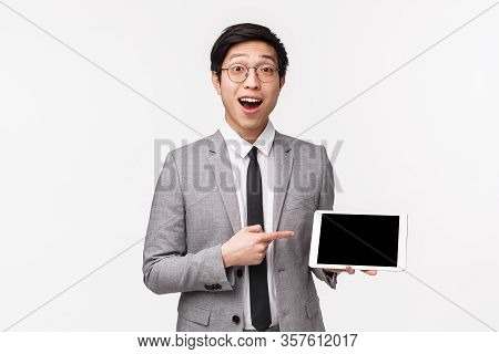 Waist-up Portrait Of Excited, Passionate Handsome Asian Man In Grey Suit Describe Great Income Of Hi