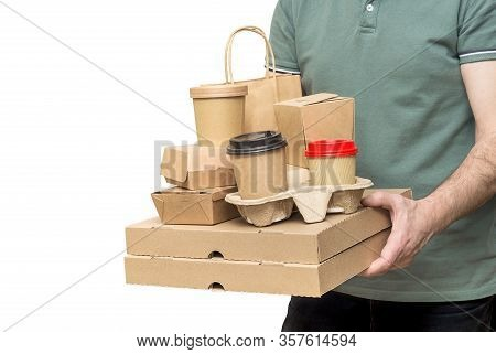 Delivery Man Carries Diverse Take-out Food Containers, Pizza Box, Coffee Cups In Holder And Paper Ba