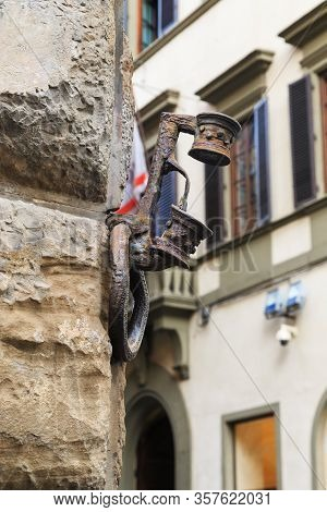 Florence, Italy - September 12, 2018: This Is A Torch Holder And A Hitching Post On The Wall Of A Me