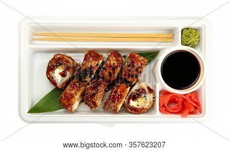 Close Up Take Away Set Of Six Unagi Sushi Rolls With Eel In Disposable Plastic Tray Isolated On Whit