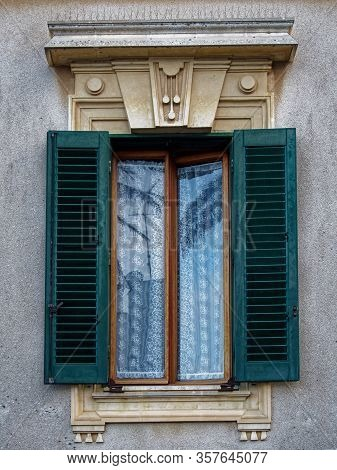 An Elegant Window Portal With Unusual Stucco On The Old House.