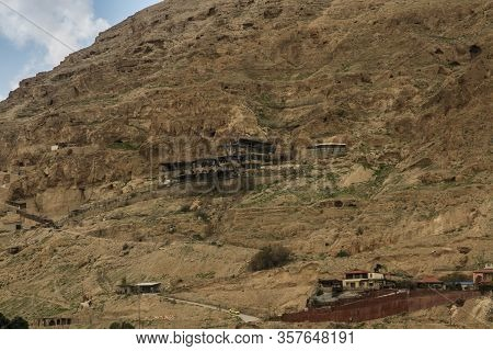 Mountainside Of Temptations Of Jesus With Tourist And Other Facilities In Jericho, Israel, Palestini