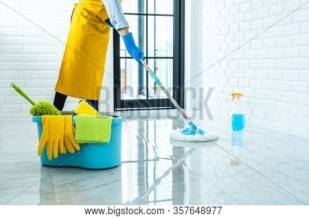 Wife Housekeeping And Cleaning Concept, Happy Young Woman In Blue Rubber Gloves Wiping Dust Using Mo