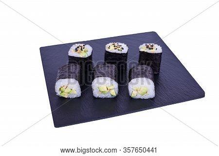 Traditional Fresh Japanese Sushi Maki On Black Stone Maki Avocado On A White Background. Roll Ingred