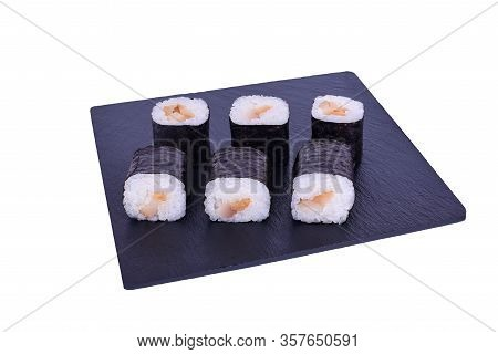 Traditional Fresh Japanese Sushi Maki On Black Stone Maki Escolar On A White Background. Roll Ingred