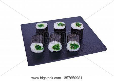 Traditional Fresh Japanese Sushi Maki On Black Stone Maki Hiashi On A White Background. Roll Ingredi