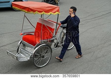 Hanoi, Vietnam, Circa January 2020: Tuk Tuk Driver And His Tuk Tuk