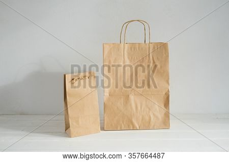 Packages Of Environmentally Friendly Material. Eco-packing. Kraft Packages Of Two Sizes.