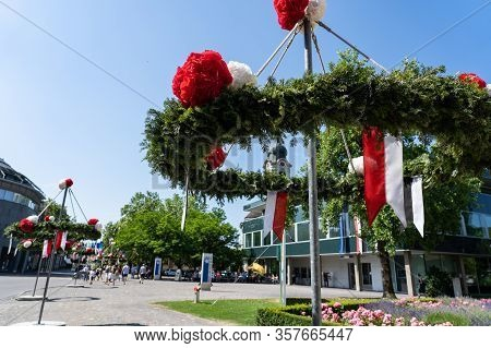 Main Street Of Brugg Decorated With Pine And Paper Flower On The 4th Of July View To The Bahnhofstra