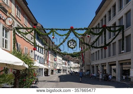 Old Town Of Brugg After Rutenzug, Decorated With Pine And Paper Flower And In The Middle Of The Stre