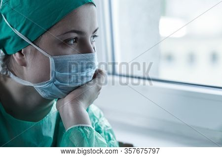 Young Female Tired Doctor After Long Work