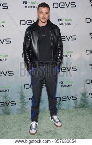 LOS ANGELES - MAR 02:  Karl Glusman Karl Glusman arrives for FX's Limited Series 'Devs' Los Angeles Premiere on March 02, 2020 in Hollywood, CA