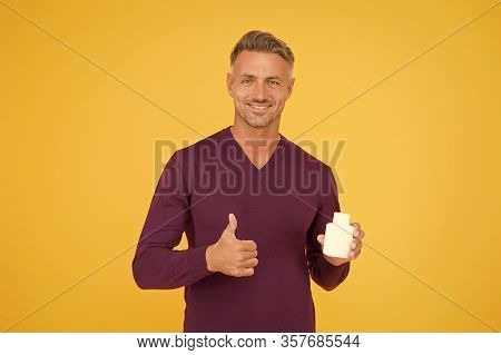 Product For Sale. Happy Guy Give Thumbs Up To Product. Handsome Man Presenting Product. Product Prom