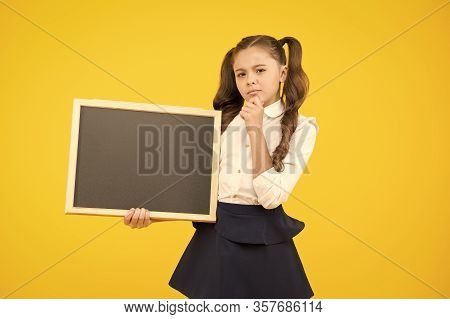 Get Information On Education. Little Child Holding Blank Blackboard For Education On Yellow Backgrou