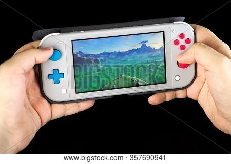 Moscow, Russia - February 18, 2020: Grey Nintendo Switch Lite. Latest Entry Into Handheld Gaming, Pr
