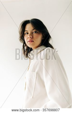 Portrait of Brunette young woman on the white background