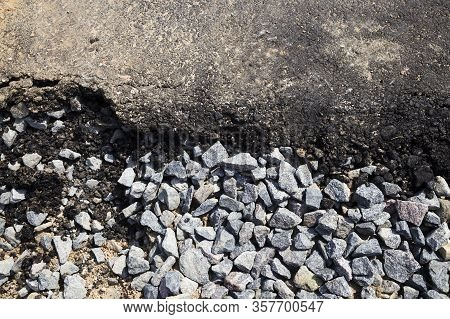 Small Rubble And A Layer Of Asphalt At The Construction Site Of A New Highway Or Roadway, Top
