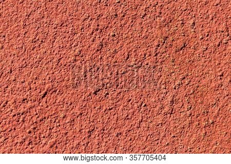 Reddish Orange Colored High-contrast And Deep Relief Cement Background Texture