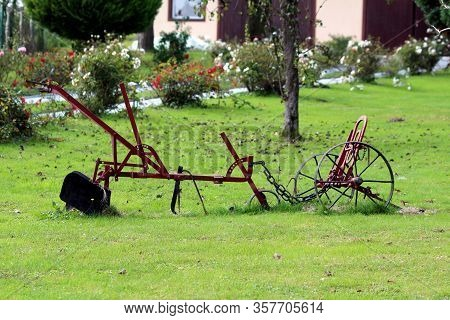 Vintage Heavily Used Broken Partially Rusted Agricultural Farming Equipment In Shape Of Small Plow N